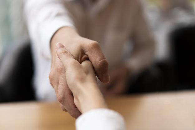 close-up-business-men-shaking-hands_23-2148377772